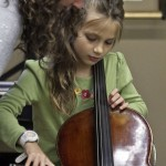 Jenny Oaks Baker helps a young cellist