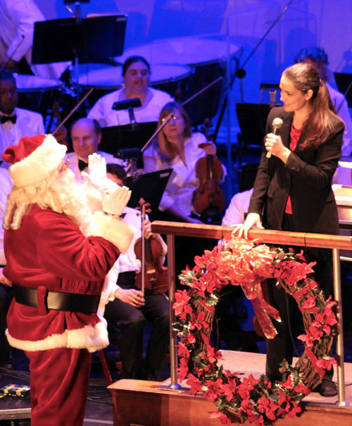 Apprentice Conductor Michelle Merrill greets Santa!