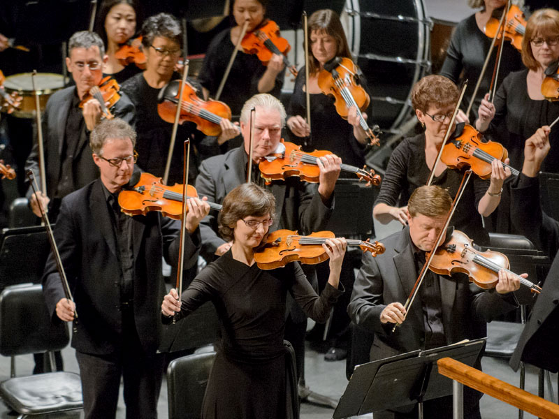 Erica Kiesewetter, Concertmaster, gives the tuning note
